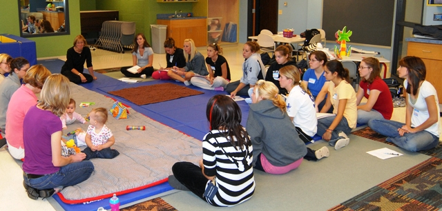 Students in human development class, observing babies