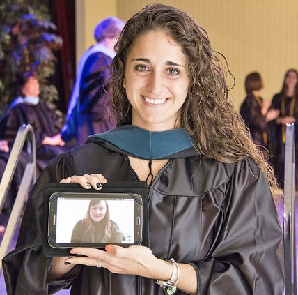 a masters OT student attends the hooding via skype and an Ipad