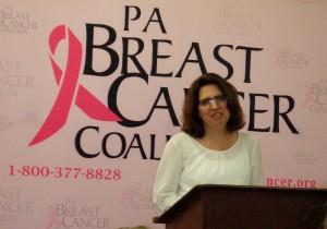 Ann Marie Potter speaks at a  Breast Cancer Survivors' Exhibit