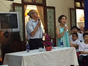 2 Vietnamese workers welcoming the group at a vocational training center