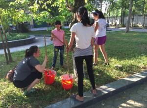 Painting trees at Ha Tinh Orphanage