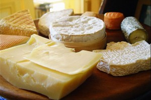various blocks and rounds of cheeses
