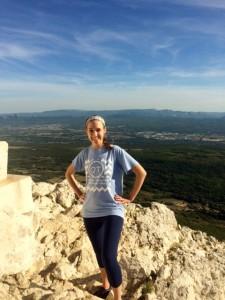 emma Johnson standing on rocky cliff overlooking water