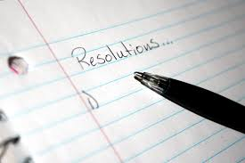 """lined notebook paper with word """"resolutions"""" on top and beginning of unwritten list below"""
